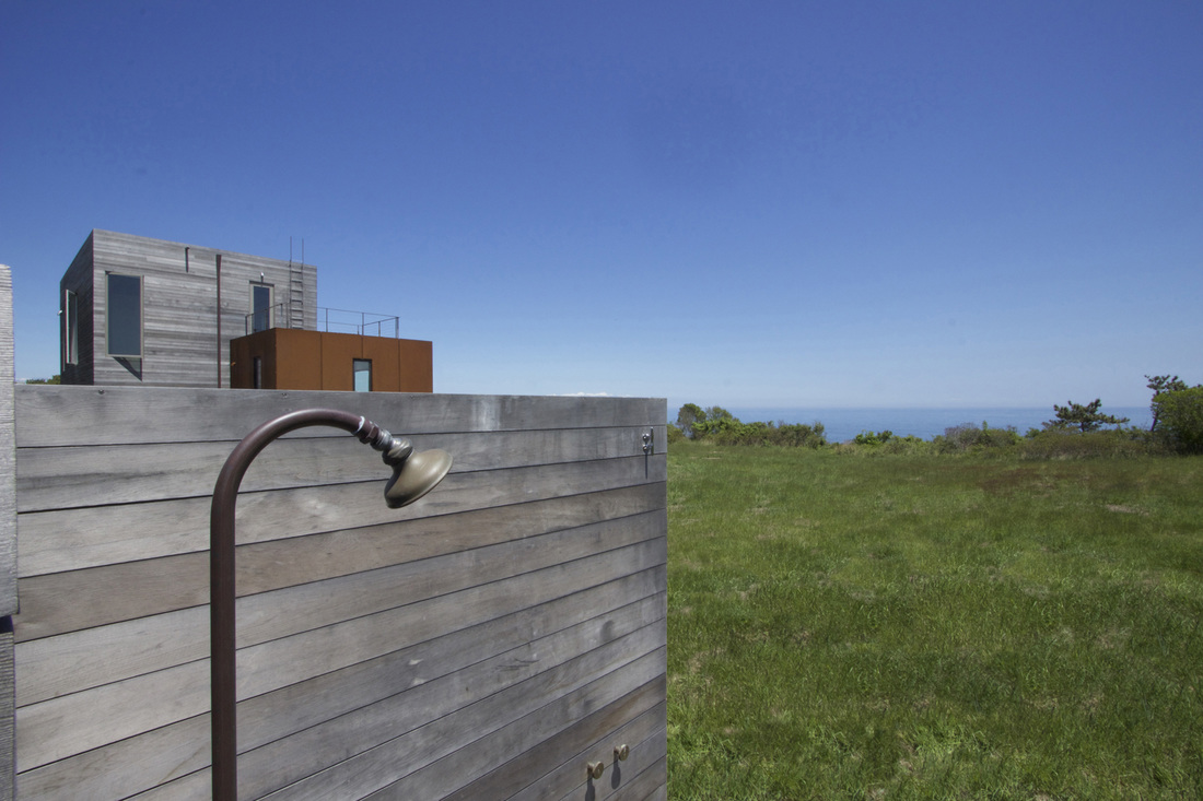 QUARTER design studio + EngineHouse | Seaside Residence | Block Island, RI – outdoor shower with ocean view