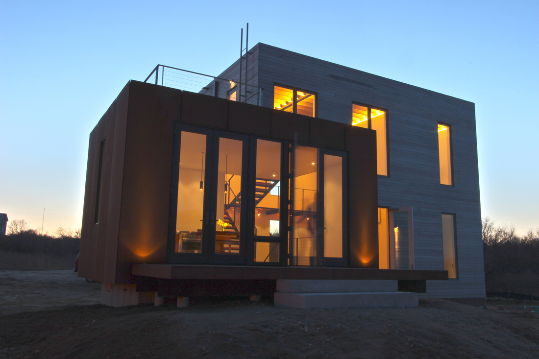 QUARTER design studio + EngineHouse | Seaside Residence | Block Island, RI – exterior at dusk (photo provided by EngineHouse)